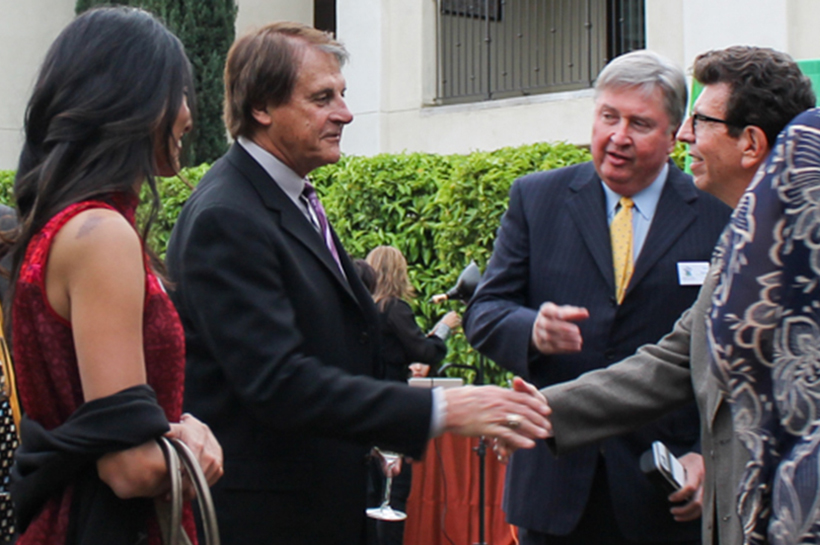 Tony LaRussa greets guests during the cocktail hour.