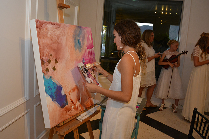 Dimitra Milan (painting the artwork that was auctioned off at the event) crop