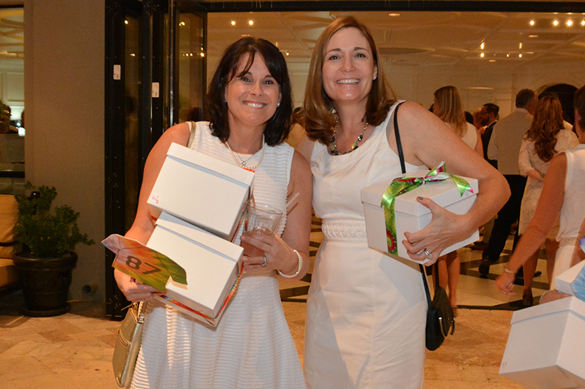 Lori Price and Marcy Cork (holding mystery boxes) crop