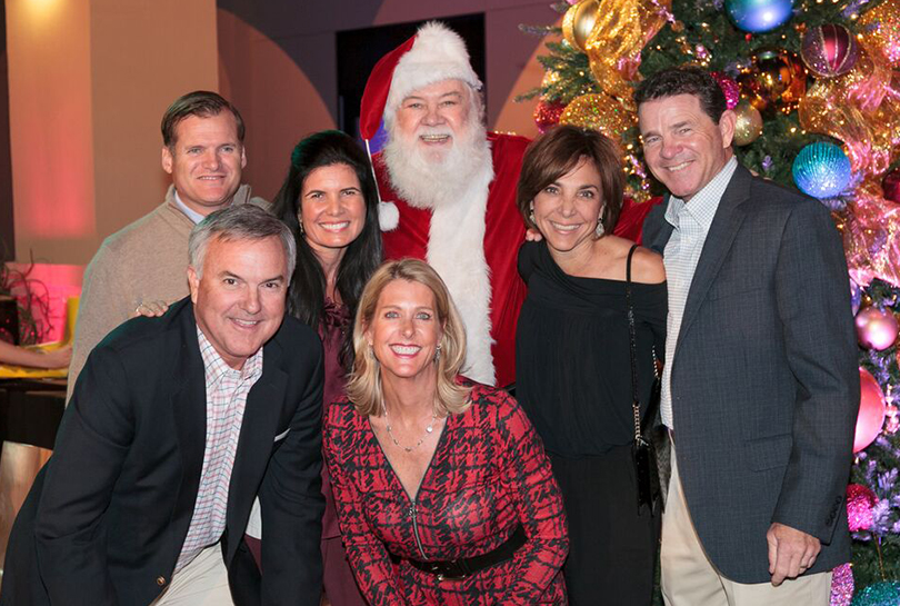 Front: Doug and Tricia Folger. Back: Steve and April Ward, Santa Claus, Denise and Wally Hale