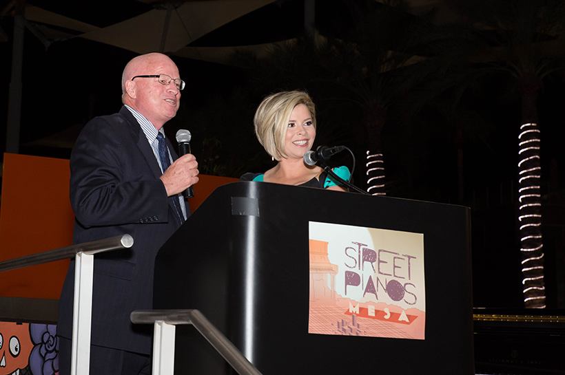 Auctioneer Mike Hutchinson and Emcee Emma Jade of 12 News crop