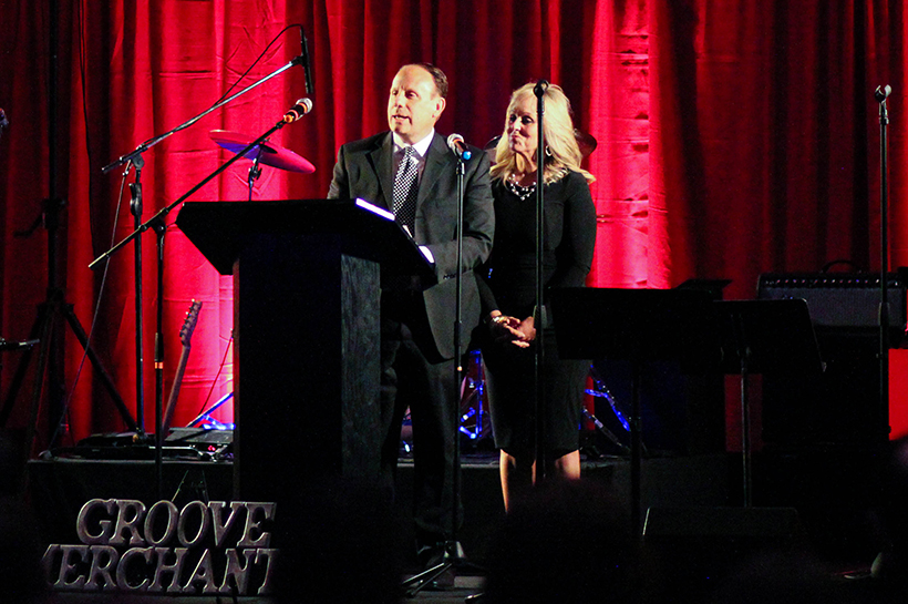 Trey and LeAnn Basha speak from the stage crop